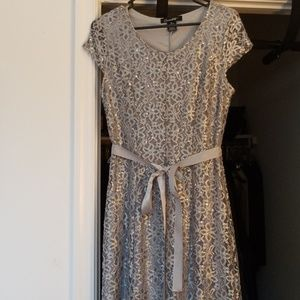 Dresses & Skirts - Silver floor length gown - Size M